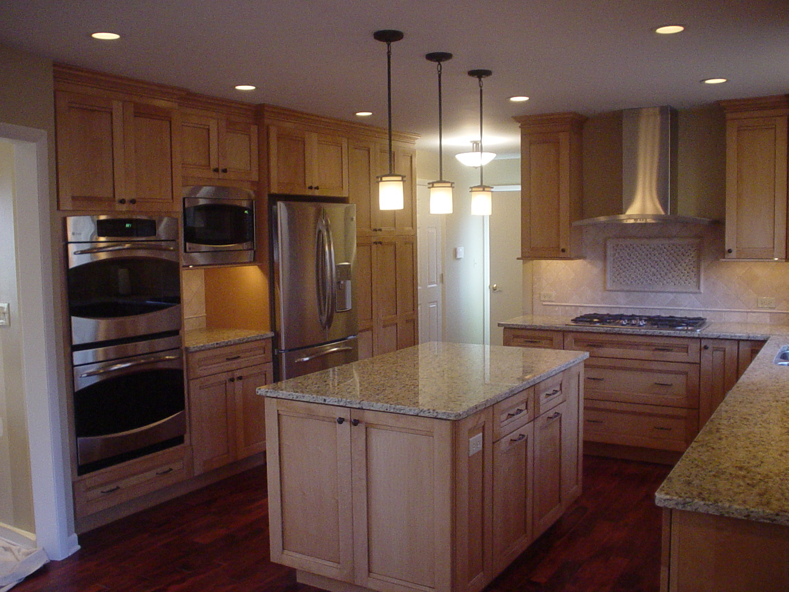 Kitchen island with overhead lighting
