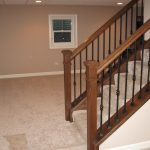 Stairs leading to a finished basement