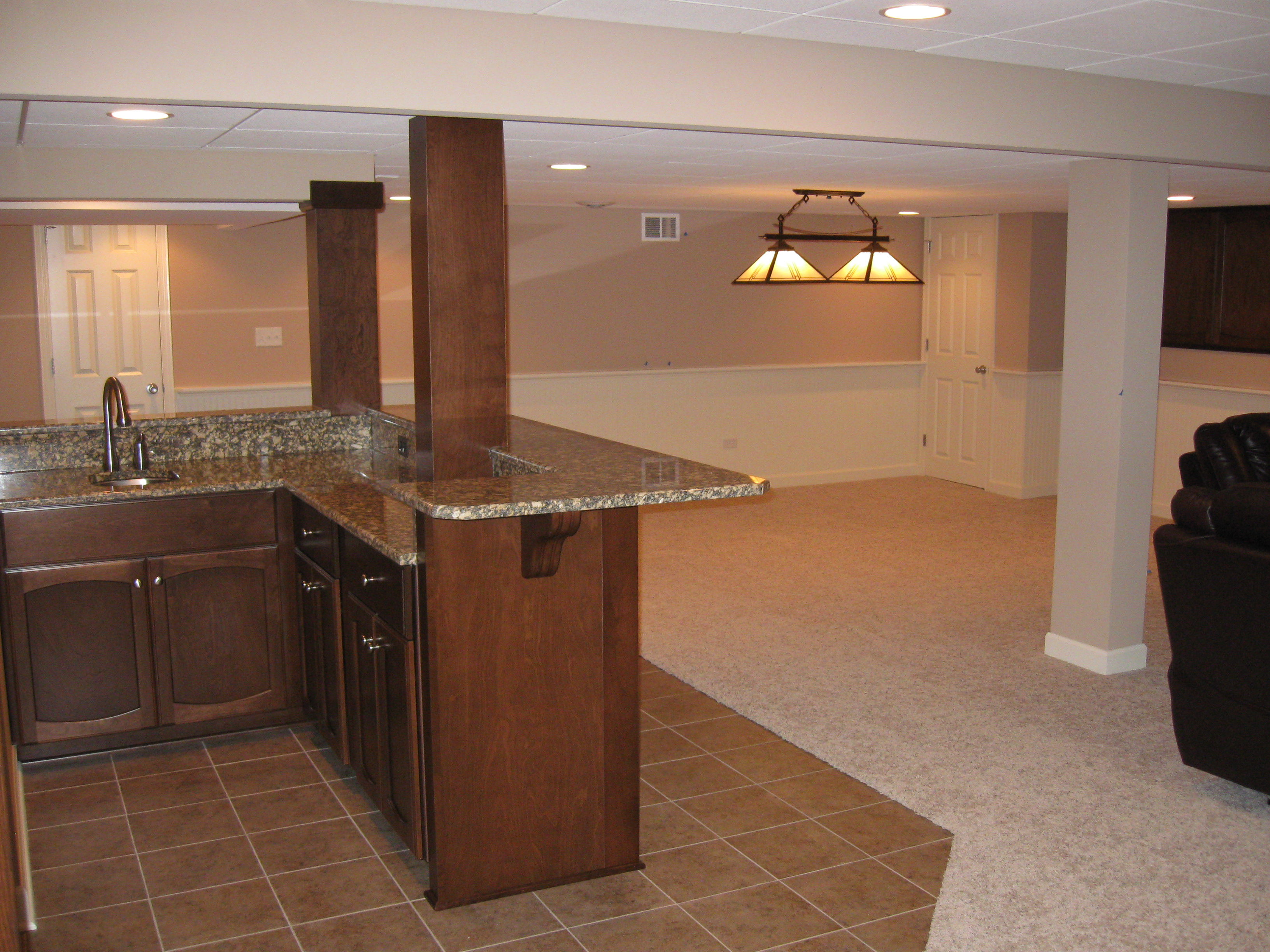 Bar and living area of a finished basement