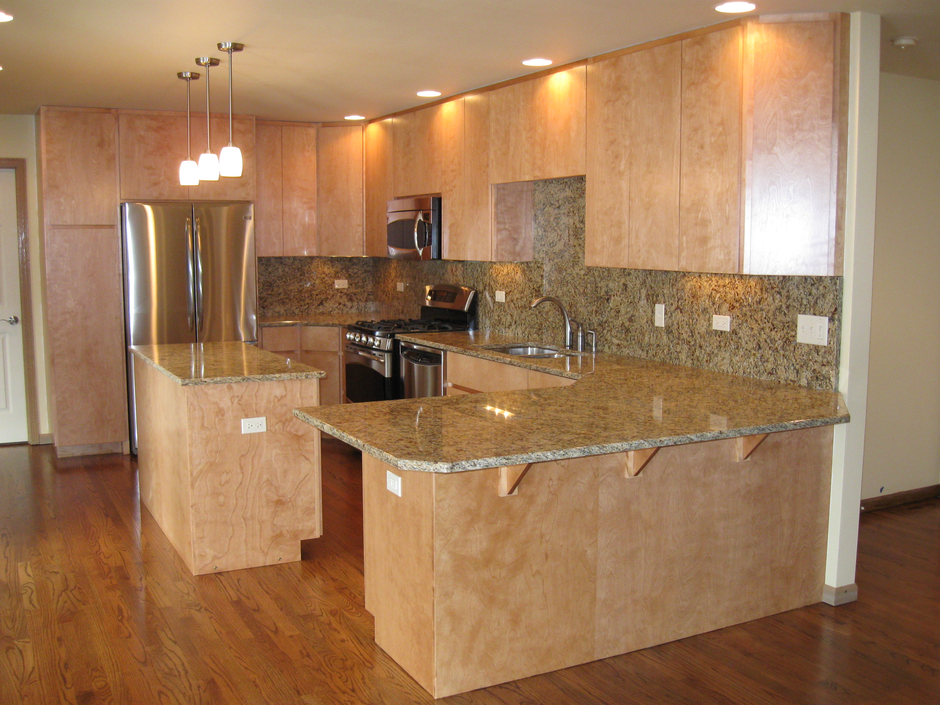 Kitchen with island and light cabinets