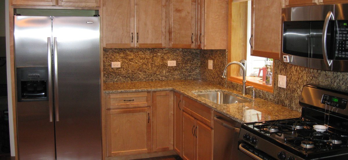 A kitchen with silver appliances