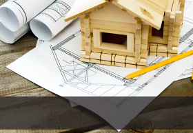 Call to action image of blueprints and a wooden model house